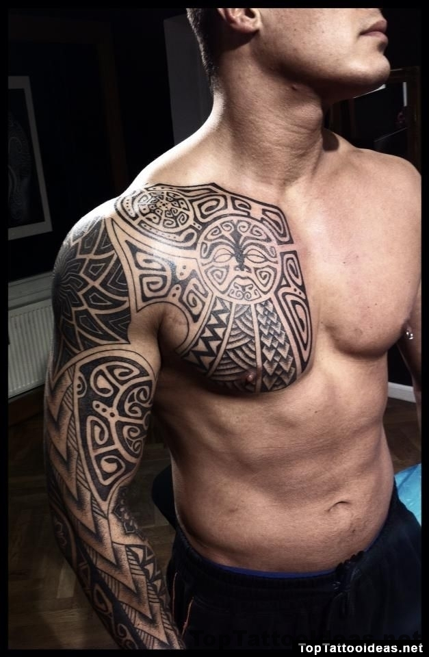 Awesome Tribal Chest And Sleeve Tattoo
