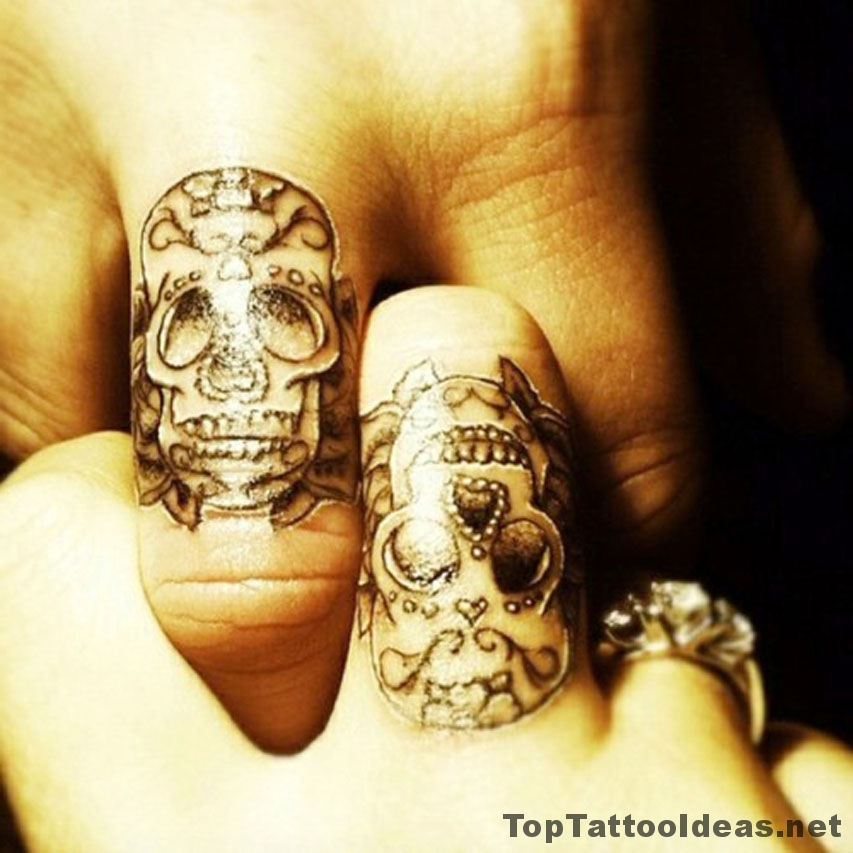 Minimal Skull Finger Tattoo Idea