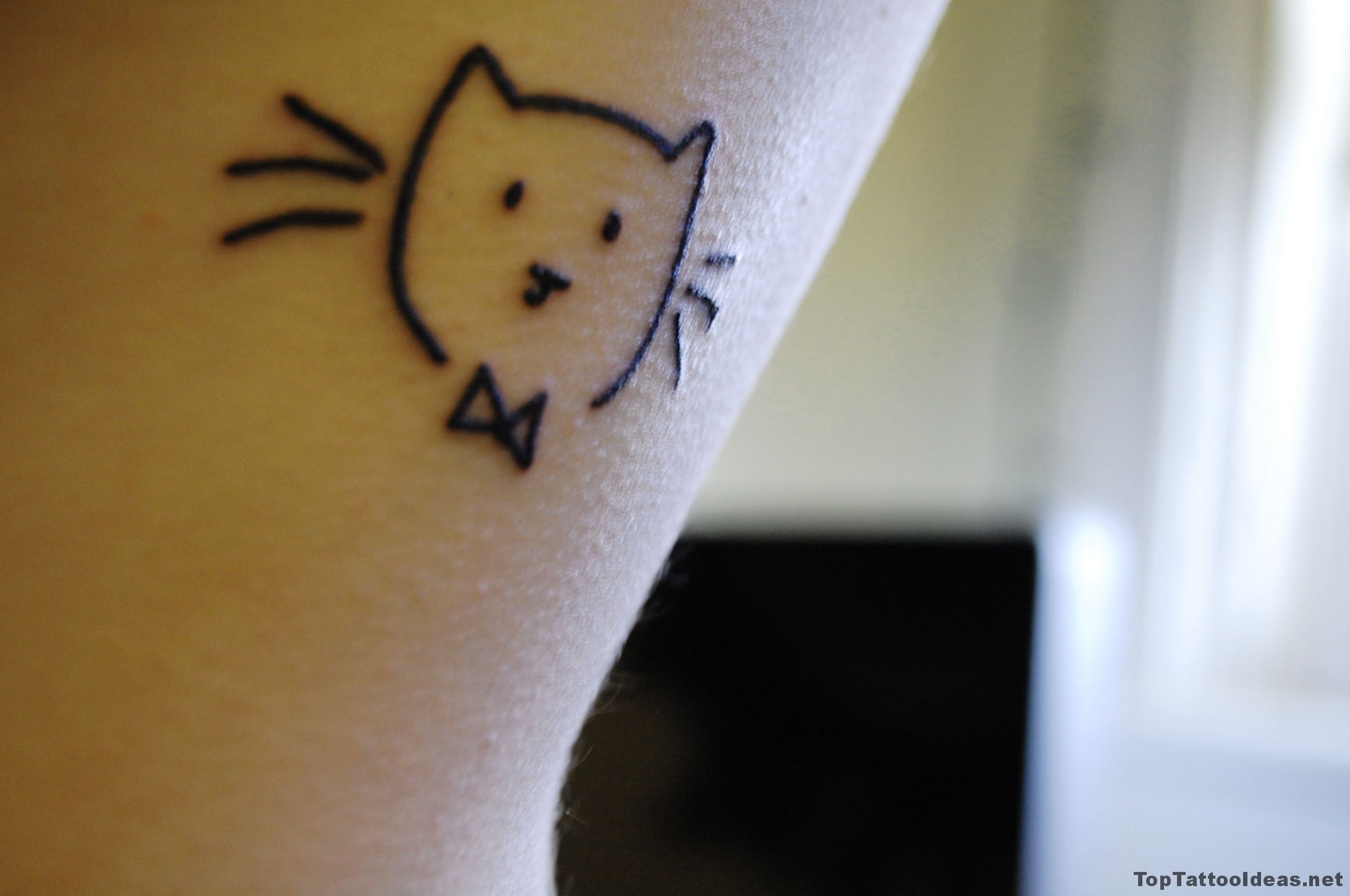Small Kitten Tattoo Idea