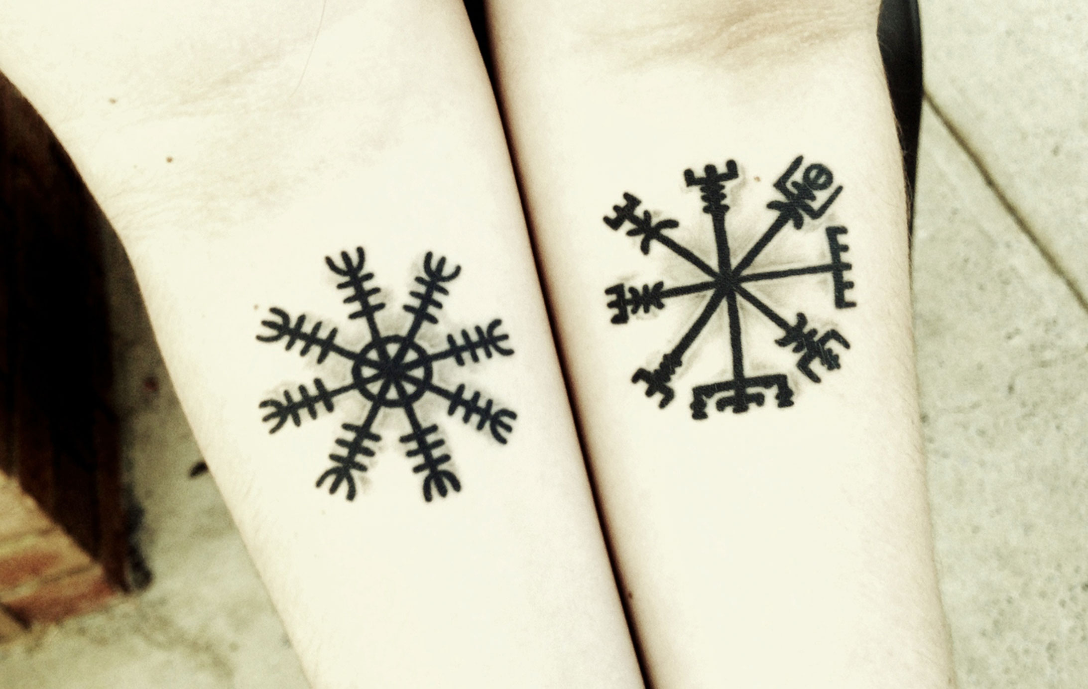 Arm Symbols Tattoo Idea