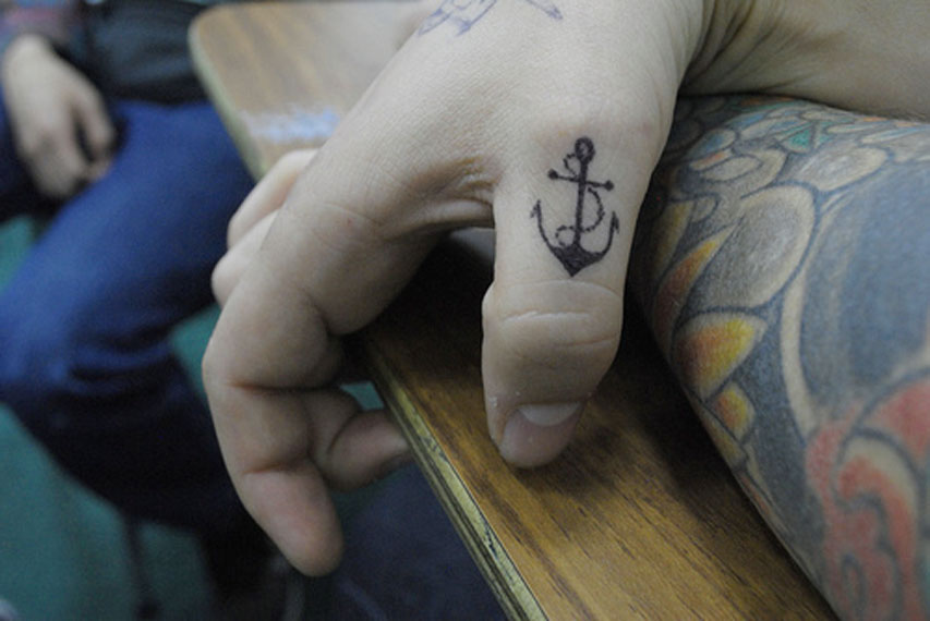 Small Anchor Finger Tattoo Idea